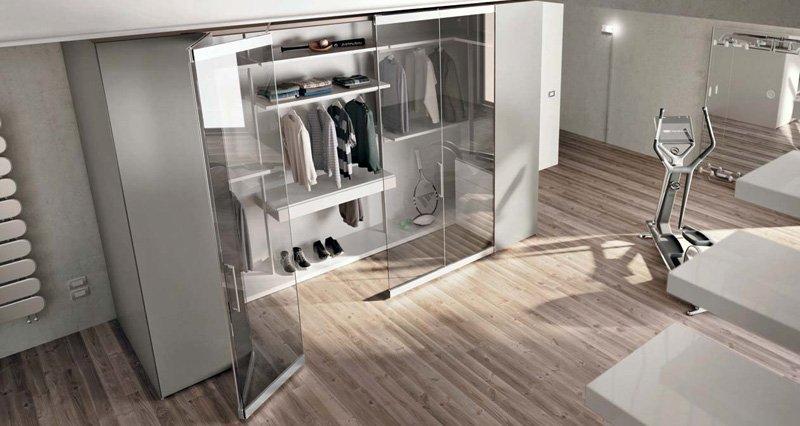 Armadi cabine per la zona notte della casa arredamento - Camera da letto con cabina armadio ad angolo ...
